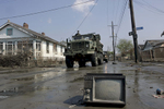 September 14, 2005 - New Orleans, Louisiana - A military truck moves along an abandoned street in the Ninth Ward.