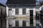 September 9, 2005 - New Orleans, Louisiana -  Receding floodwater leaves its mark on a house and automobile on Orleans Avenue.