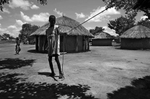 September 13, 2014 - Lapul - Ocwida village - Okot David, 18, standing  outside his hut. Okot represents a severe case of Nodding Syndrome; he has been ill with it since 2003. He's tied to his living quarters 24-hours a day, seven days a week. At an advanced stage the syndrome causes its victims to wander aimlessly, hence families will tie the person with a rope or chain to prevent them from getting lost, injured or in the case of a young woman raped.