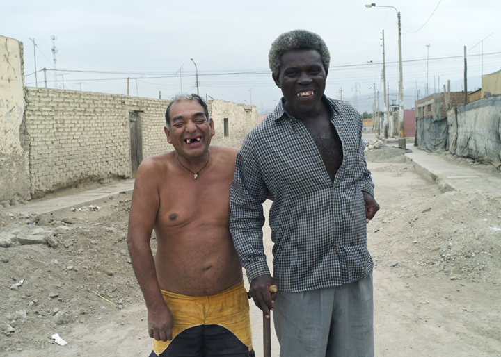 Peruvian neighbors pose for a photograph.