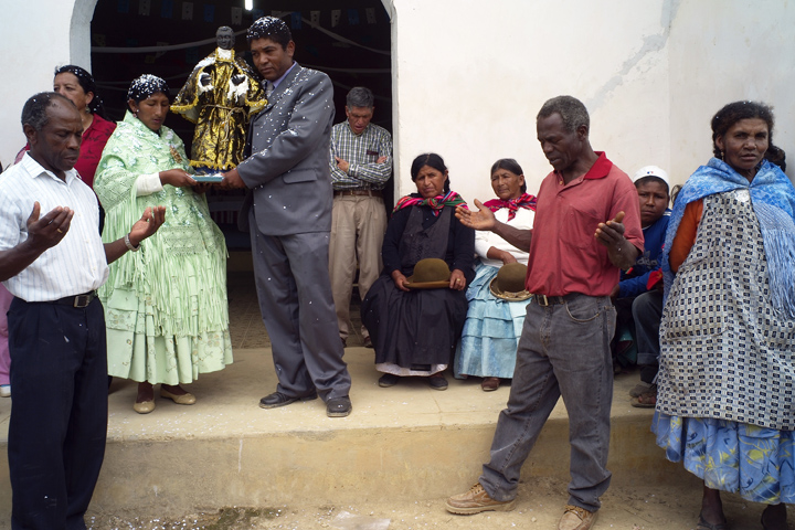Afro-Bolivians and indigenous neighbors participate in a ceremony marking a religious festival ('Fiesta de San Benito').
