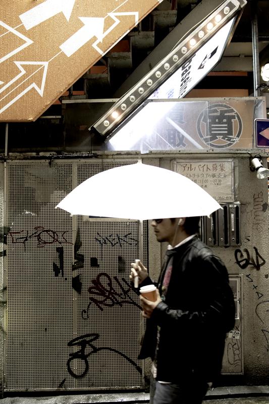 tokyo-guy-under-umbrella