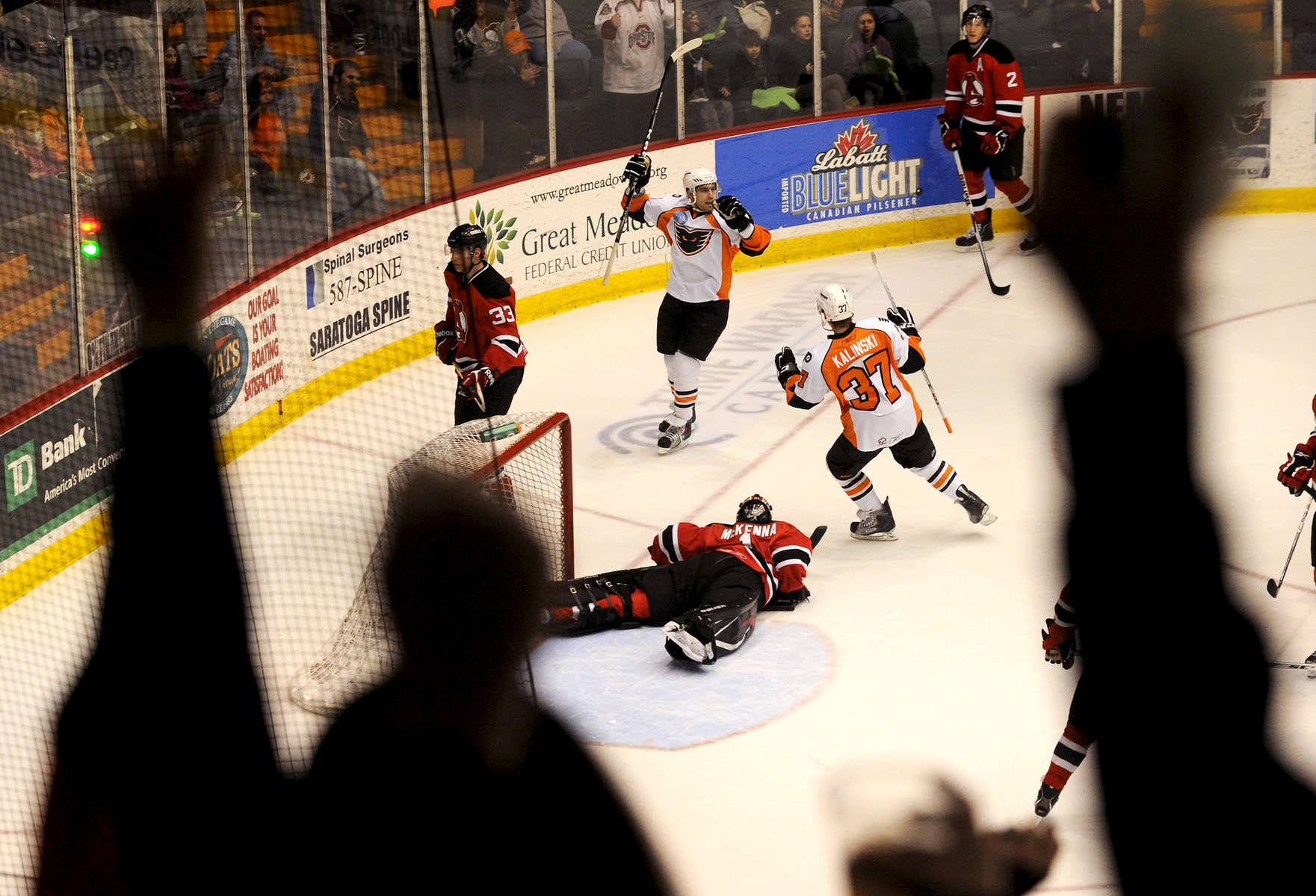 Jason McKibben - jmckibben@poststar.comAlbany Devils goalie Mike McKenna is splayed on the ice and Phantoms fans celebrate as Jonathon Kalinski, 37, and Cullen Eddy react to Eddy\'s second period goal that put the Phantoms ahead 6-2 Friday night, April 1, 2011, at the Glens Falls Civic Center. McKenna was pulled from the game after the goal and replaced by Jeff Frazee.
