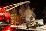 Jason McKibben - jmckibben@poststar.comWest Glens Falls and South Queensbury firefighters work the scene of a house fire on Fawn Lane in Queensbury Monday evening, November 8, 2010. One occupant was helped to safety by a neighbor and was taken to the hospital for treatment of burns. There were no other injuries reported.