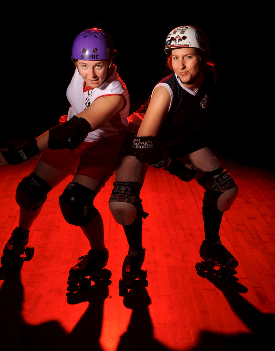 (04/25/2010) (Photo by Jason McKibben) Photographs for Colby Magazine article on roller derby. Sequence starts with portraits of Lisa Jade (wearing white helmet and navy uniform) and Amanda Vickerson (wearing purple helmet and red/white uniform). Next are photos of Lisa Jade warming up with the Port Authorities. Following the warmup photos are action shots of an actual Port Authorities bout against the Harrisburg Area Roller Derby's Nuclear Knockouts (in neon green and black). The Port Authorities beat the Harrisburg team 273-44.