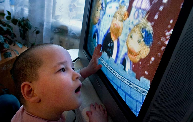 An 11-year-old child sees a television for the first time. The volunteers donated the television and some DVDs to the orphanages in order to provide at least some stimulation.
