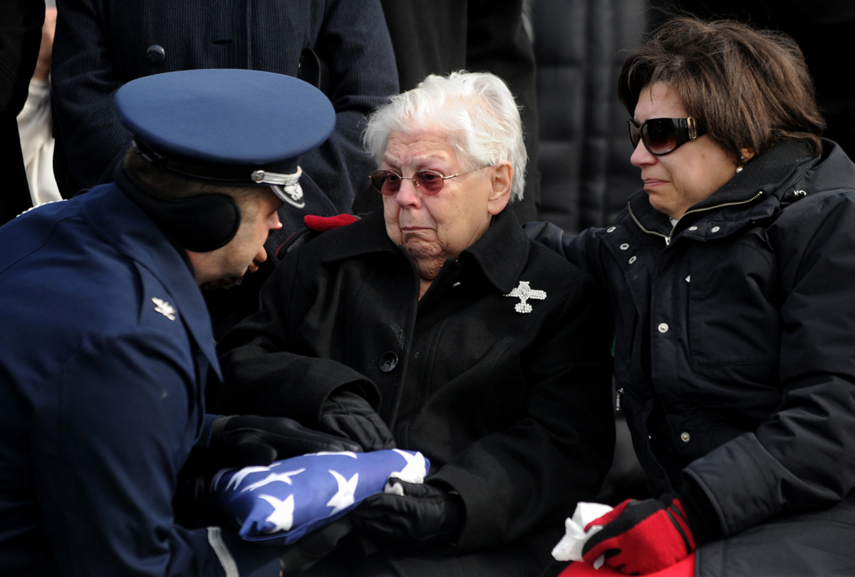 Mildred {quote}Millie{quote} Dart is presented the flag  by Col. John Russo of the United States Air Force's 109th Airlift Wing Honor Guard during the military funeral honors for her husband, Lt. Col. Clarence Dart, at the Greenridge Cemetery in Saratoga Springs, Tuesday, February 21, 2012. Lt. Col. Dart, a former Tuskegee Airman who flew nearly 100 missions and was twice shot down by the enemy in World War II, was also the father of nine children. He died last Friday. He was 91.