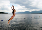 Alice Fox, 9, leaps off the dock and into Lake George at Diamond Point Beach Tuesday, August 28, 2012. Fox was swimming and practicing diving with her sister, Ella, and their mother at the beach as the sun went in and out of the clouds. (Jason McKibben - jmckibben@poststar.com)