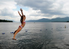 Alice Fox, 9, leaps off the dock and into Lake George at Diamond Point Beach Tuesday, August 28, 2012. Fox was swimming and practicing diving with her sister, Ella, and their mother at the beach as the sun went in and out of the clouds.