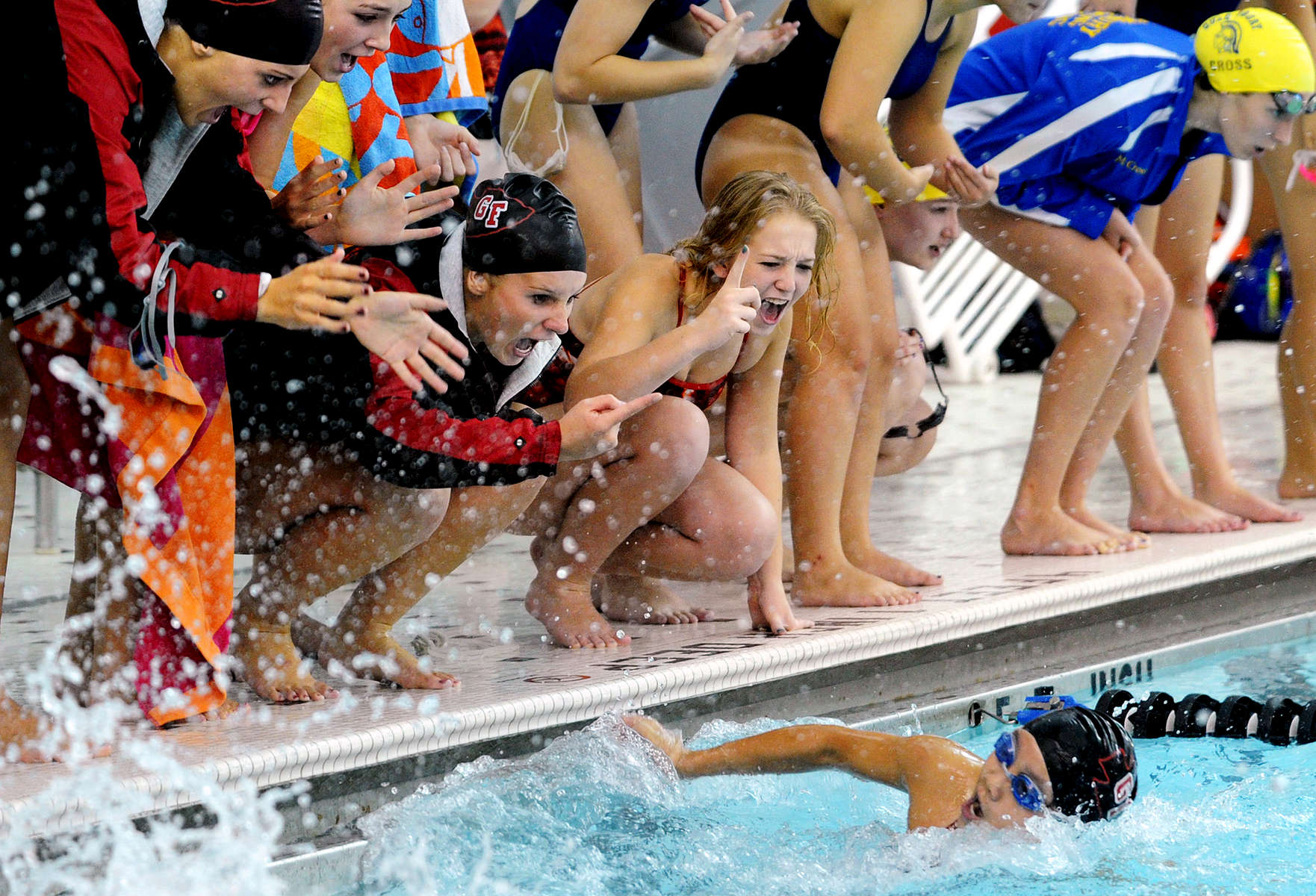 Jason McKibben - jmckibben@poststar.comGlens Falls\' Mia Cote gets a lot of vocal encouragement from her teammates as she swims in the 100-yard butterfly event against Queensbury Thursday, September 29, 2011, at Glens Falls High School. Cote finished in 1st place with a time of 1:05.66.