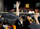 Jason McKibben - jmckibben@poststar.comSkidmore graduate Colleen Hughes sports a quote from the Dr. Seuss book \{quote}Oh, The Places You\'ll Go!\{quote} on her mortarboard during the school\'s 100th commencement exercises Saturday, May 21, 2011, at the Saratoga Performing Arts Center.