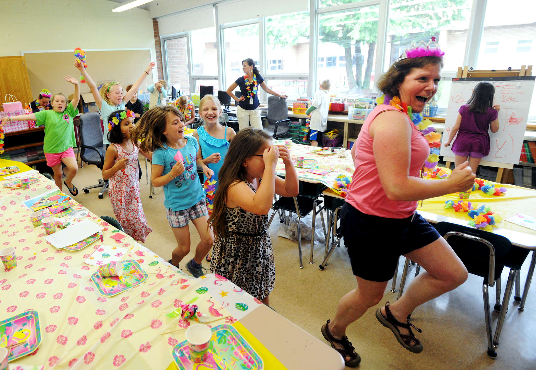 Kensington Road Elementary School teacher Pam Laurent leads third-graders in a dance party minutes before dismissal on the last day of the school year Thursday, June 26, 2014. Glens Falls elementary students were dismissed at 9:30 a.m. Thursday, which gave them just enough time to receive their report cards, get their yearbooks signed by classmates and teachers, and have a little fun before the beginning of summer break.(Jason McKibben - jmckibben@poststar.com)