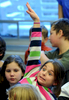 Jason McKibben - jmckibben@poststar.comEmily Clark, a 4th-grader at Greenfield Elementary School, emphatically raises her hand to answer a question posed by guest scientist Steve \{quote}The Dirtmeister\{quote} Tomecek during a workshop in the school\'s library Friday, December 16, 2011. Tomecek was visiting the school Thursday and Friday to offer fun and interactive ways to approach science and writing.