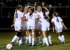 South Glens Falls players huddle around Sammy Blizzard, raising her arms, after she scored a goal to go ahead of Queensbury 2-1 in the first half of their Foothills Council soccer game in South Glens Falls Thursday, September 13, 2012. Blizzard would go on to score the deciding goal late in the second half to give South High a 4-3 victory. (Jason McKibben - jmckibben@poststar.com)