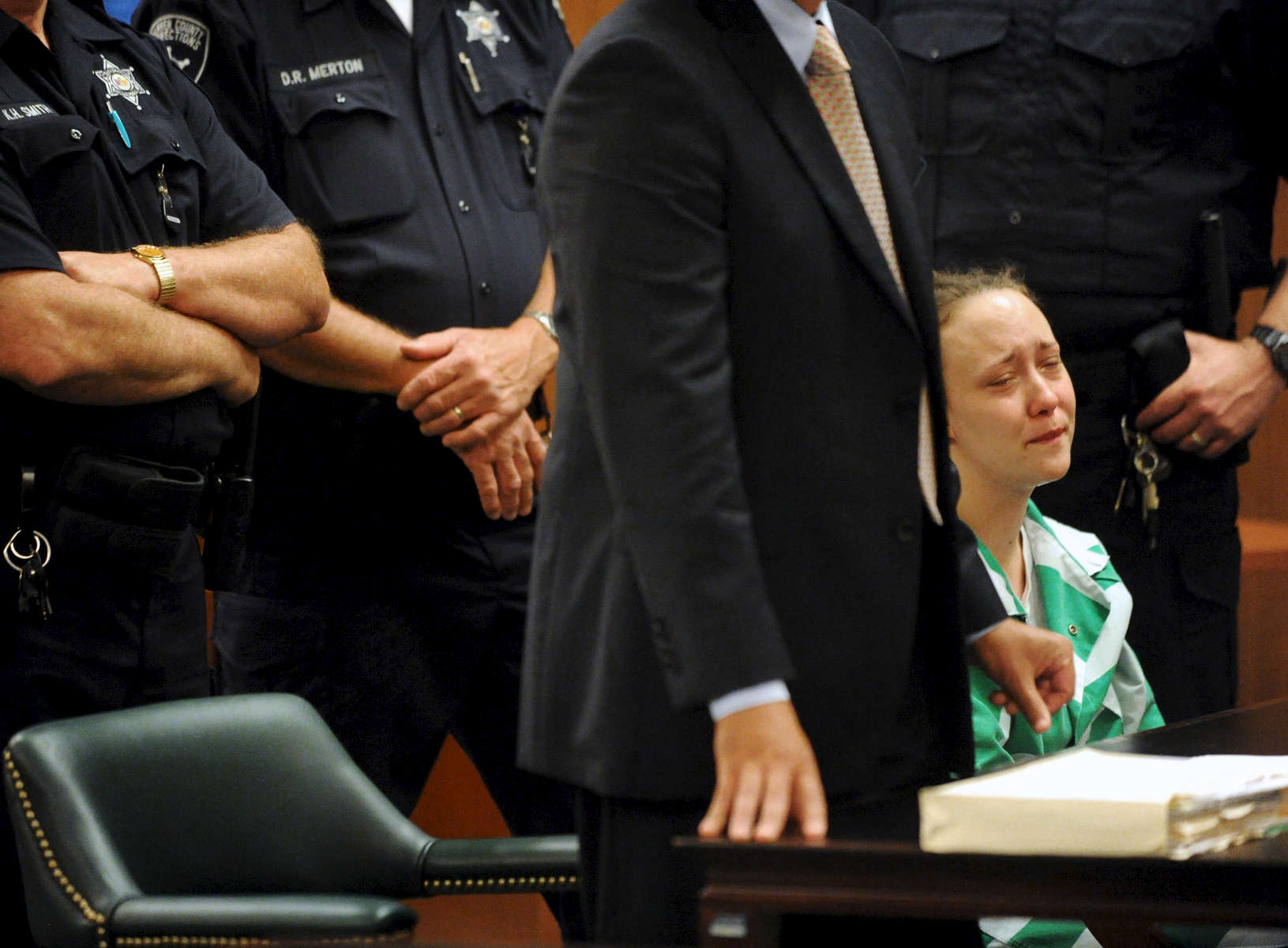 A tearful Jennie Mattison is surrounded by security personnel as she listens as her lawyer Tucker Stanclift address Warren County Judge John Hall during her sentencing hearing Tuesday, July 23, 2013. She was sentenced 1 to 3 years in prison for hindering the prosecution in the beating death of her son, Gary Carpenter III, by her boyfriend, Brandon Warrington. {quote}I think every day abou Gary. I cry every night. I regret not protecting him like I should have,{quote} Mattison told the court.(Jason McKibben - jmckibben@poststar.com)