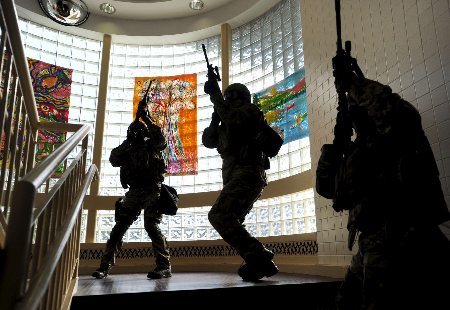 Jason McKibben - jmckibben@poststar.comMembers of the new Warren County Sheriff's Office Emergency Response Team participate in an {quote}active shooter{quote} drill at William H. Barton Intermediate School in Queensbury Sunday, October 17, 2010. The drill included shooting victims and a mock gunman that police had to locate and disarm. The victims were then transported to the Glens Falls Hospital where staff practiced their response to such an event.