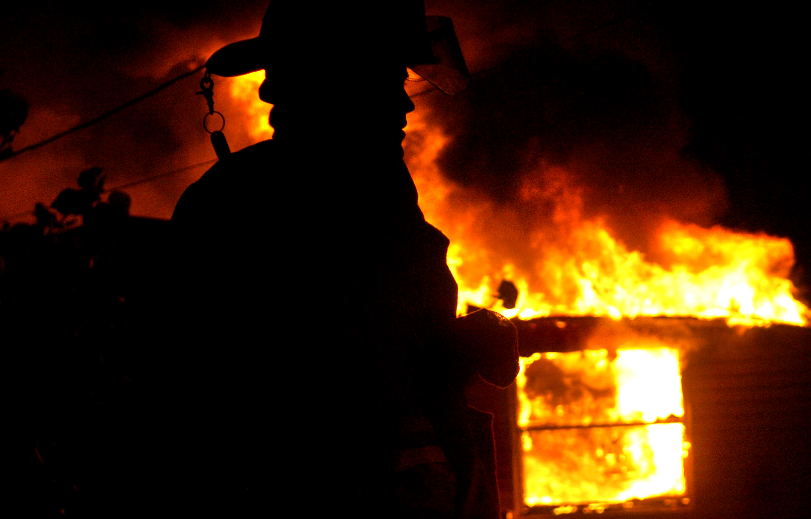 A Nokomis volunteer firefighter works a mobile home fire at 116 Ruby Ave. Wednesday, July 11, 2007. The department sent 26 firefighters, two engines, a tanker and a ladder truck to the blaze which is currently being ruled arson; no one was injured. Set up in the 1950s and sustained by dues and donations, Nokomis' fire department might soon be absorbed by the fire department of Sarasota County because of population growth.