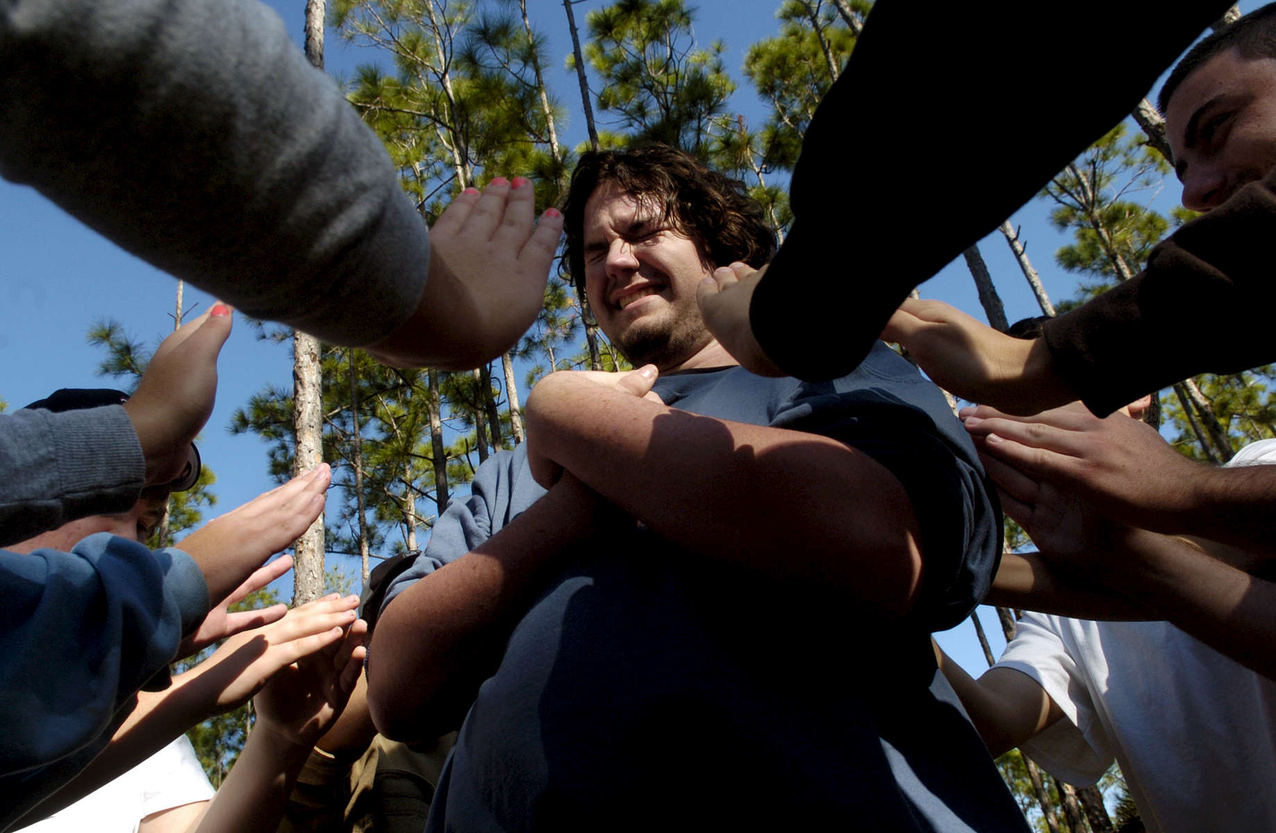 Joel Sherrer, 17, of Venture Crew 39 in Arcadia, Florida, apprehensively falls backwards into the hands of other scouts during a Challenging Outdoor Personal Experience (C.O.P.E.) course. About 30 teen scouts took part in the team and trust building course.