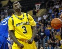 Michigan guard Manny Harris (3) celebrates after scoring in front of Creighton's Kenny Lawson, Jr. during overtime of an NCAA basketball game in the Old Spice Classic tournament in Lake Buena Vista, Fla., Thursday, Nov. 26, 2009.  Michigan won 83-76.
