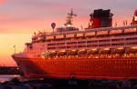 Disney Cruise Lines cruise ship Magic ports at sunrise in Cape Canaveral, Florida.