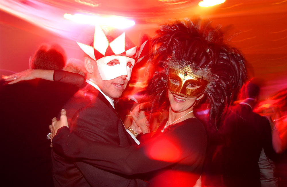 Two revelers dance the night away during a Masquerade Ball in Kissimmee, Florida.