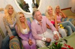 Playboy founder Hugh Hefner photographed with his {quote}girlfriends.{quote}
