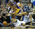 Los Angeles Lakers guard Kobe Bryant, left, and the Orlando Magic's Maurice Evans, center, and Brian Cook battle for a loose ball during the first half of their NBA basketball game in Orlando, Florida.