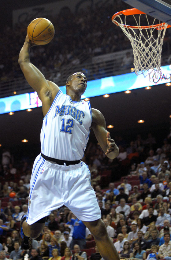 Orlando Magic center Dwight Howard soars for a dunk during the first half of their NBA basketball game against the Los Angeles Lakers in Orlando, Florida.