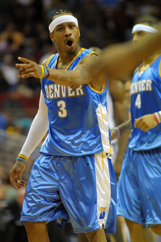 Denver Nuggets guard Allen Iverson, left, argues a call during the second half of their NBA basketball game against the Orlando Magic in Orlando, Florida.