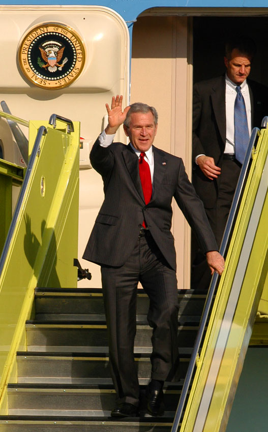 President George W. Bush waves to well-wishers after arriving at Orlando International Airport for a Republican Party dinner in Orlando, Florida.