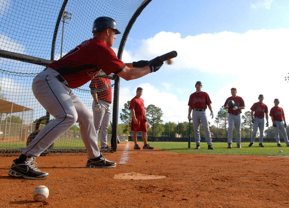 Houston Astros pitcher Brad James, left, lays down a few bunts during batting practice of the team's Spring Training in Kissimmee, Florida.