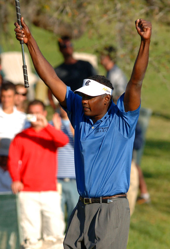 Vijay Singh, of Fiji, raises his club on the 18th green after winning the Arnold Palmer Invitational golf tournament in Orlando, Florida.