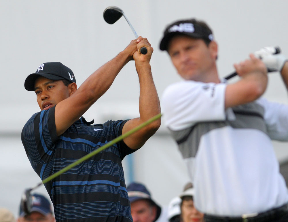 Tiger Woods, left, and Mark Wilson take practice swings before the start of the second round of the Arnold Palmer Invitational golf tournament in Orlando, Fla., on March 27, 2009.