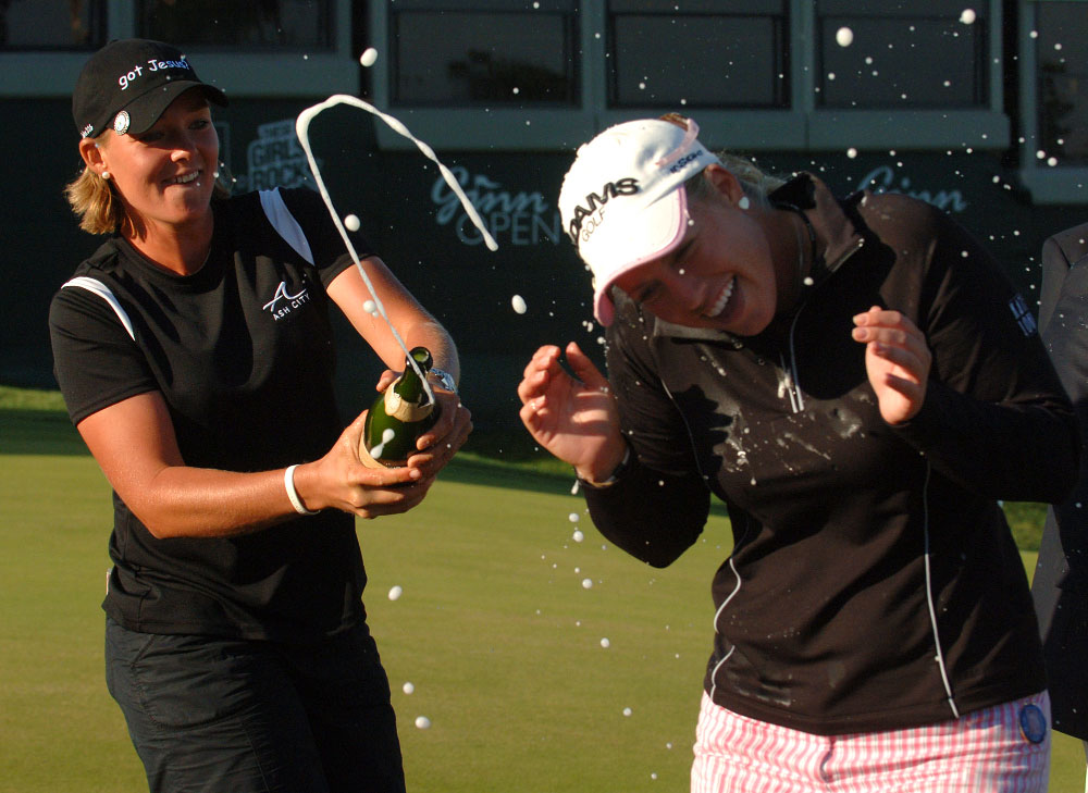 Fellow golfer Katherine Hull, left, sprays champagne on Brittany Lincicome after winning the Ginn Open golf tournament in Reunion, Florida.