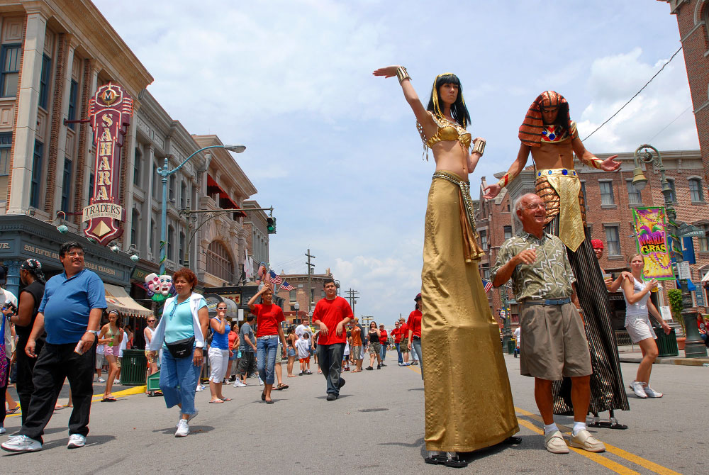 A pair of stiltwalkers dressed in ancient Egyptian costumes entertain tourists at the Universal Studios Florida theme park in Orlando, Florida.