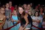 Miley Cyrus is mobbed by fans during the Disney Channel Games in Lake Buena Vista, Florida.