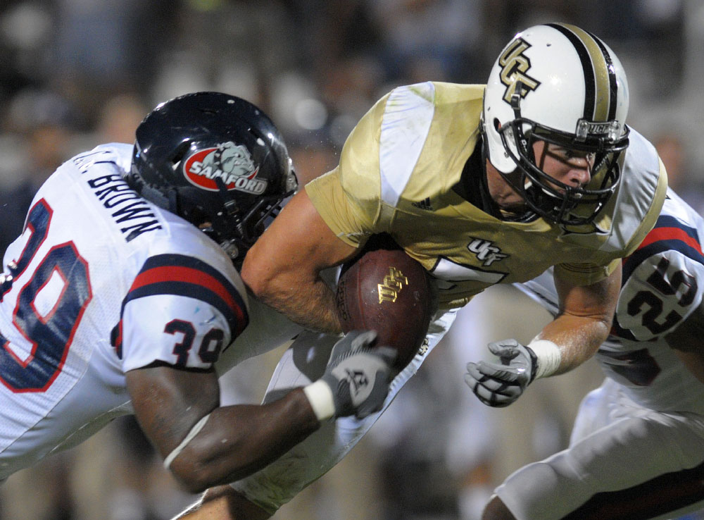 Central Florida wide receiver Rocky Ross, center, is stripped of the ball by Samford linebacker C.J. Brown (39) after catching a pass during the first half of an NCAA college football game in Orlando, Fla., Saturday, Sept. 5, 2009.  Samford recovered the fumble in the endzone for a touchback.