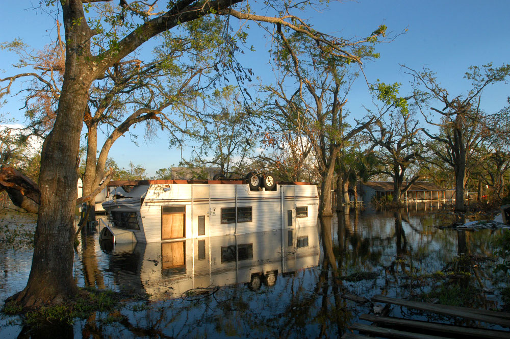 A mobile home sits in a flooded trailer park after Hurricane Charley swept through the region in Arcadia, Florida.