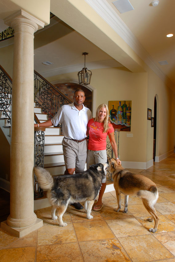 Boston Celtics head basketball coach Doc Rivers and his wife, Kris, and their two dogs Ellie, left, and Mickey, in the home in Winter Park, Florida.