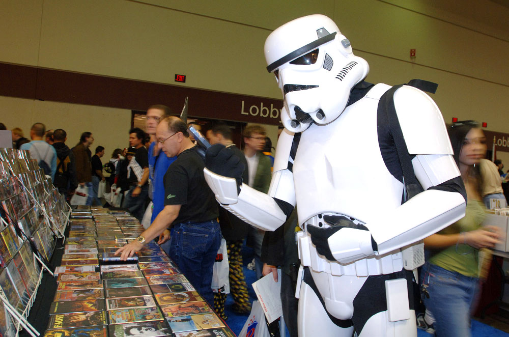 Larry Harcar, right, of Key West, Florida., looks at DVDs while dressed as a Stormtrooper from {quote}Star Wars{quote} at the MegaCon comic books convention in Orlando, Florida.