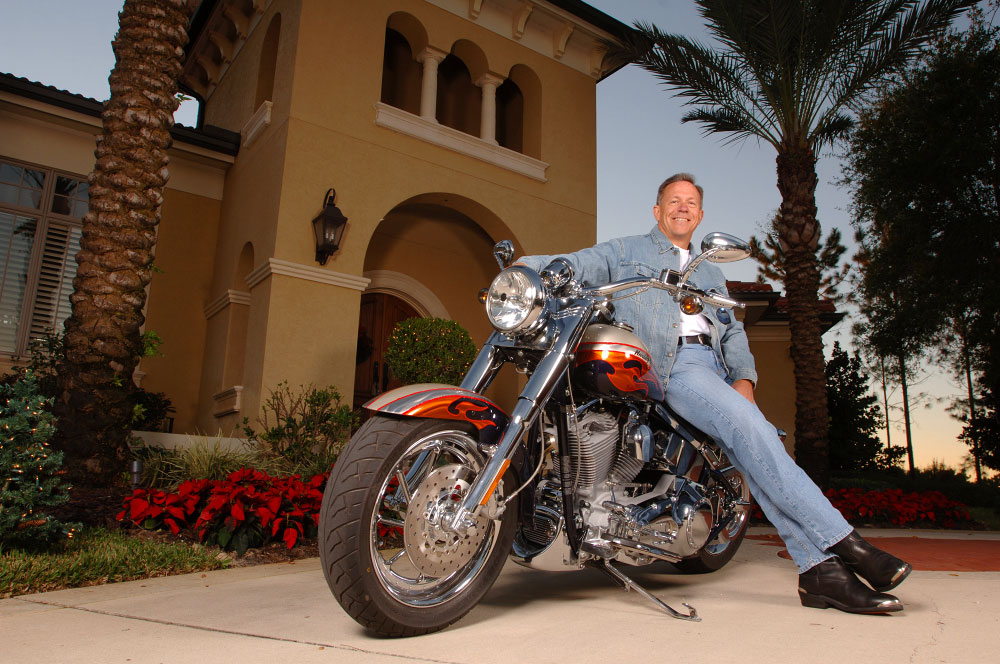 Hughes Supply CEO Tom Morgan photographed with his Harley in front of his home in Windermere, Florida.