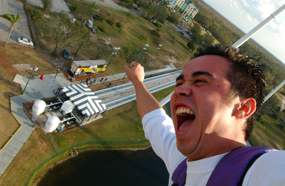 A rider takes flight on a thrill ride in the tourist corridor of Kissimmee, Florida.