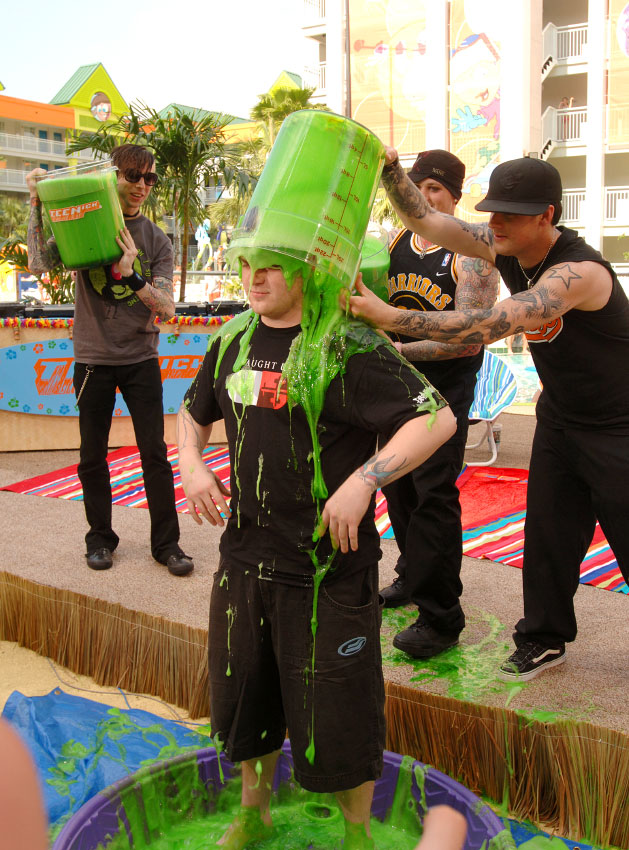 Members of the musical group Good Charlotte play with green slime in Orlando, Florida.