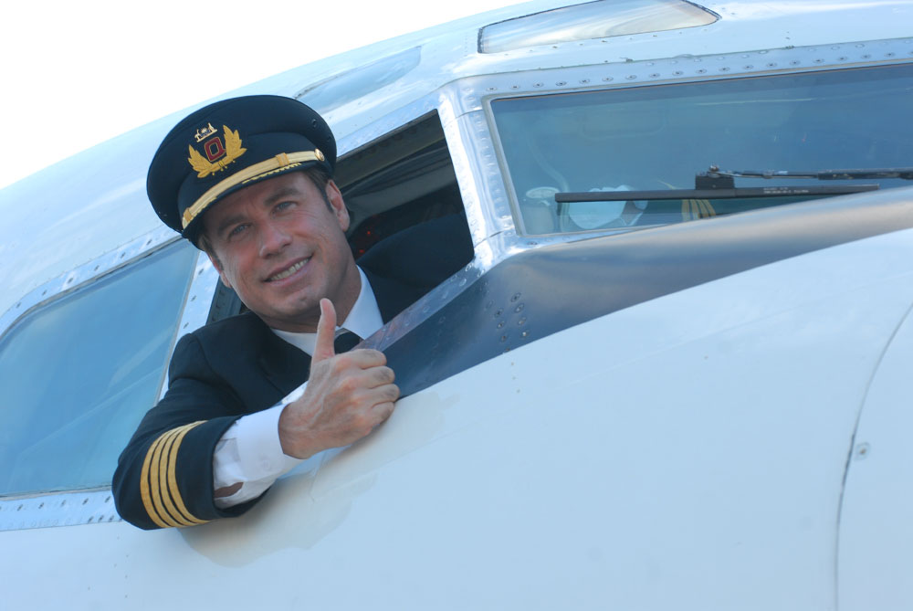 Actor and pilot John Travolta in his Boeing 707 at Orlando International Airport, photographed for Qantas Airlines.