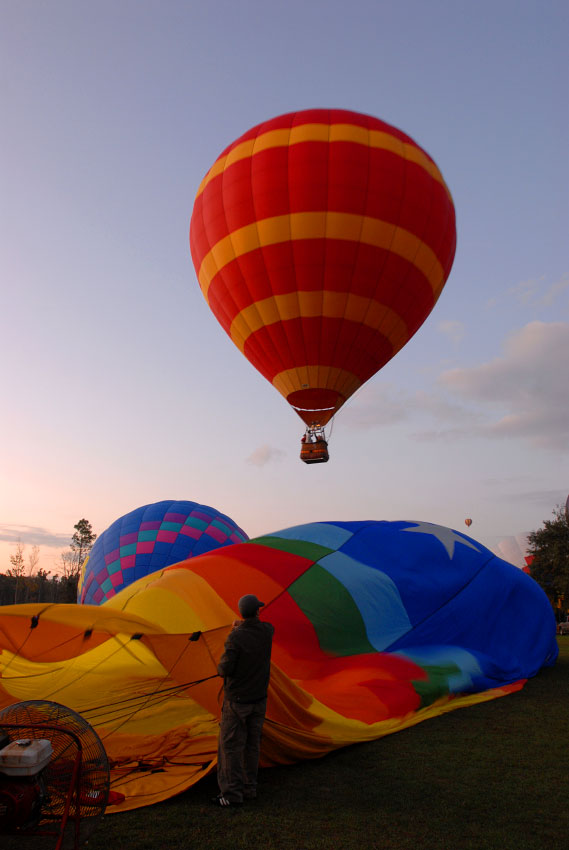 Riders take flight in a hot air balloon as the sun rises in Kissimmee, Florida.