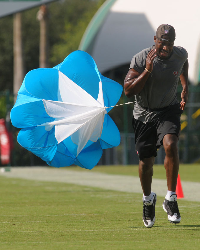 Tampa Bay Buccaneers running back Carnell Williams rehabilitates a surgically repaired torn patellar tendon by running parachute drills during the team's training camp in Lake Buena Vista, Florida.
