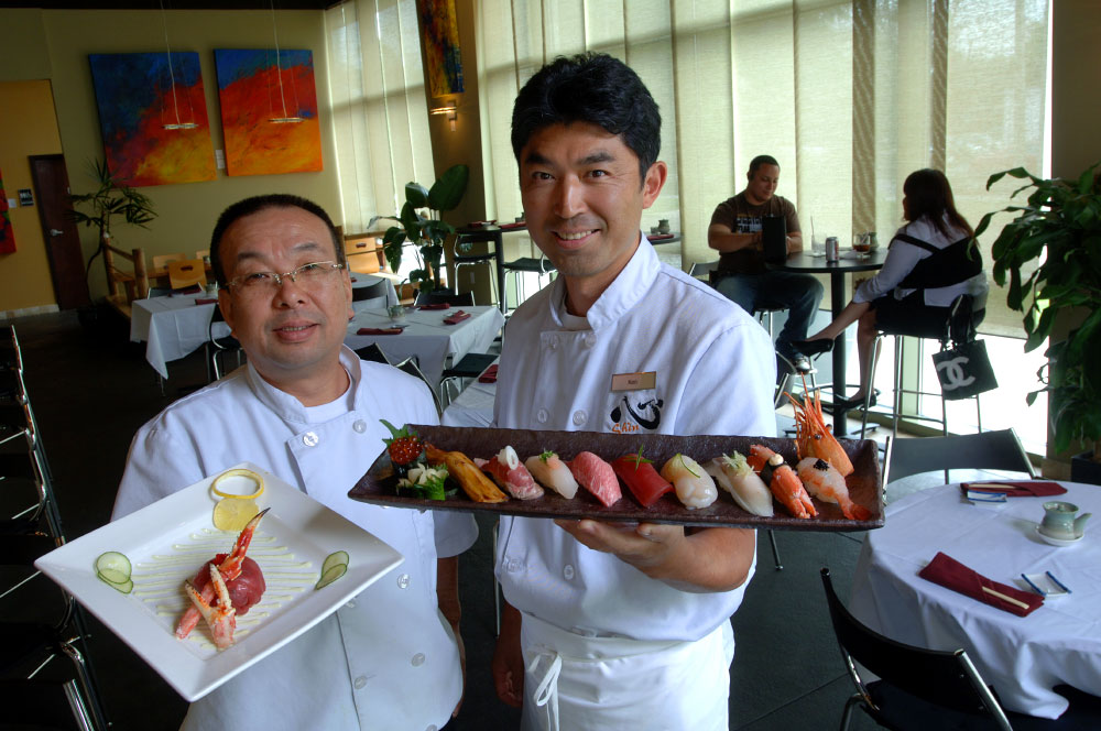 Shin Sushi Japanese restaurant owners Kenji Okamoto, left, and Ken Sakurada with a selection of their fresh sushi selection.