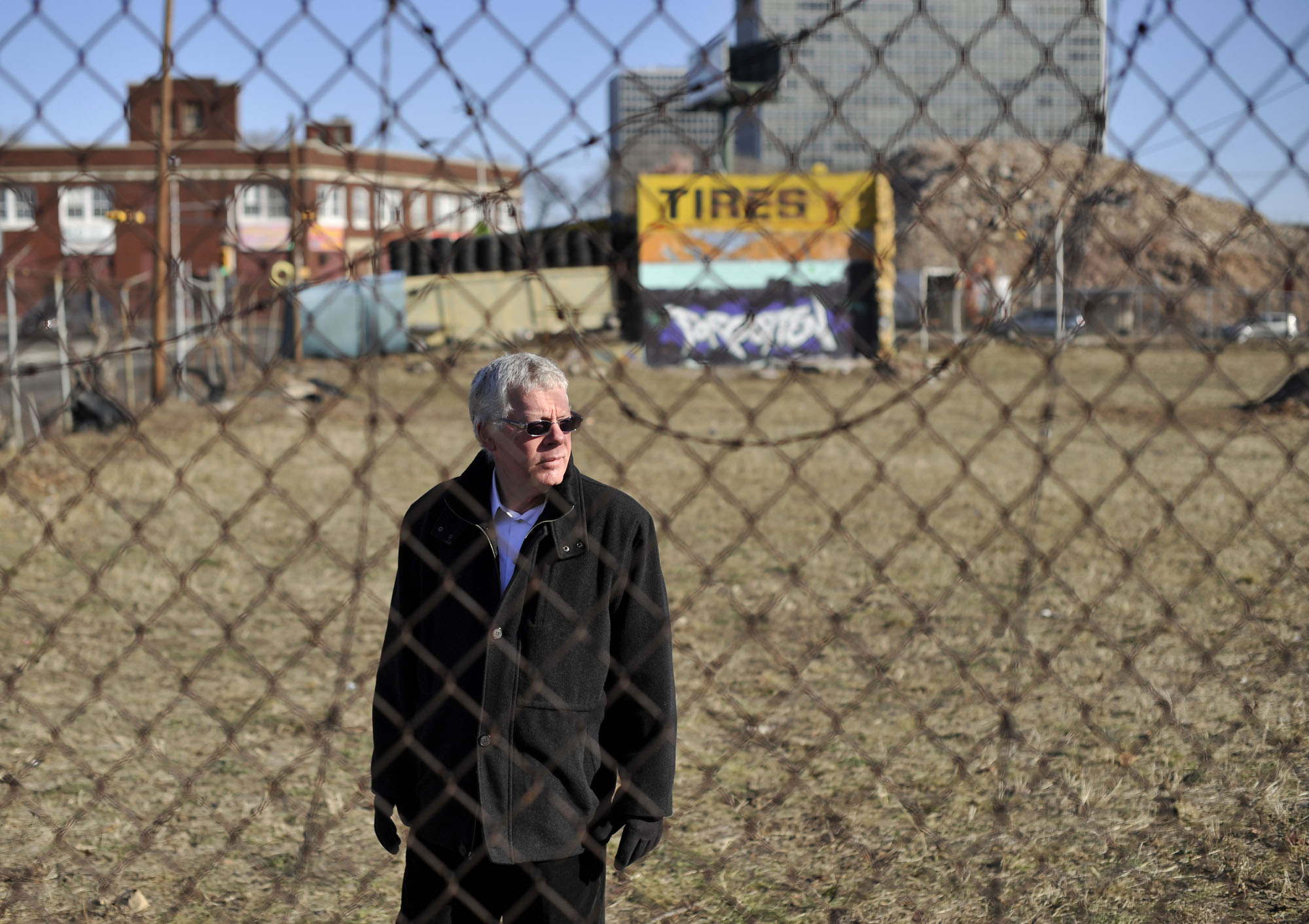 Guy Sterling, a well known writer stands at the spot of the famous Wolf Muslin Undergarment Company factory fire in Newark, NJ.  Photographed for The New York Times