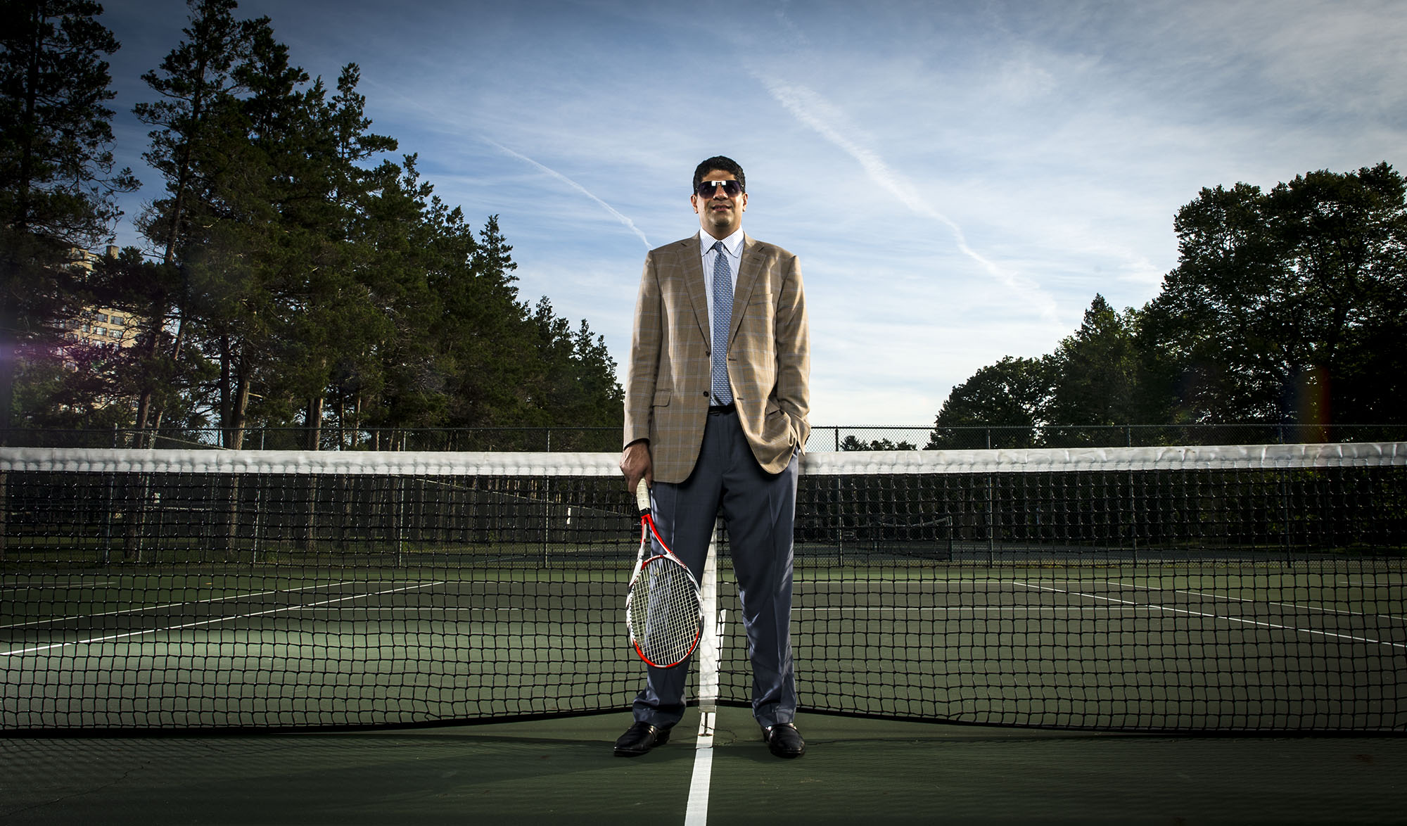 Cardiologist Dr. Ramzan M. Zakir MD is an avid Tennis player. He is photographed at Buccleuch Park in New Brunswick, NJ for Saint Peter's University Hospital.
