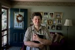 Rose, an uninsured NJ resident clutches her Bible at home. Photographed for Catholic Health East